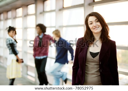 A portrait of a young woman with friends in the background - stock photo