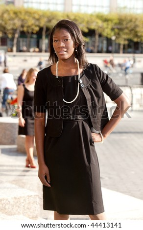 A portrait of an African American business woman outdoors - stock photo