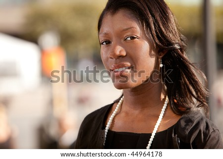 A portrait of an African American business woman outdoors