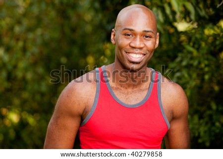 A portrait of an african american man taking a break from exercising - stock photo
