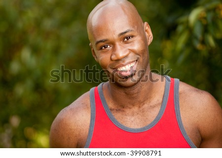 A portrait of an African American man taking a break while exercising - stock photo