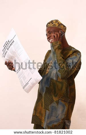 A portrait of an african american man with newspaper and mobile phone - stock photo