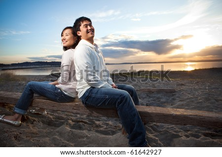 A portrait of an asian couple having fun outdoor - stock photo