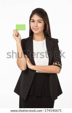 A portrait of an Asian Woman in business formal black suit holding a green blank name card with her fingers. Isolated on white background. Close up half body. - stock photo