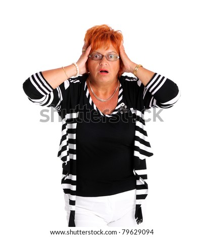 A portrait of an attractive woman in her fifties being surprised over white background