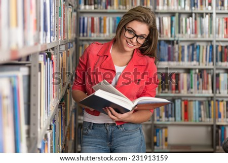 A Portrait Of An Caucasian College Student Girl In Library - Shallow Depth Of Field - stock photo