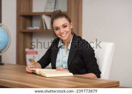 A Portrait Of An Caucasian College Student Woman In Library - Shallow Depth Of Field - stock photo