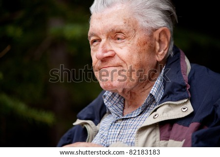 A portrait of an elderly man in the forest - stock photo