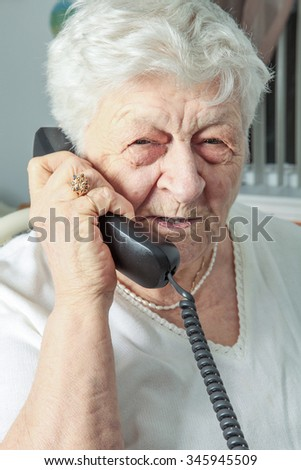 A portrait of an elderly woman on the phone