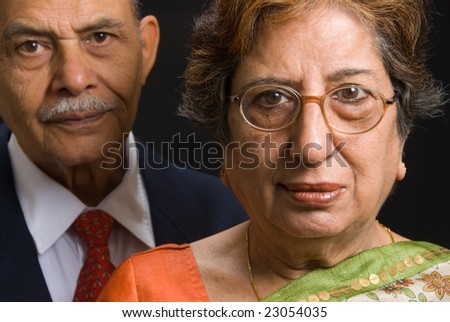 A portrait of an elegant East Indian couple - focus in on the lady - stock photo