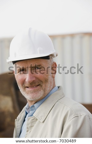 A portrait of an engineer in the early morning fog - stock photo