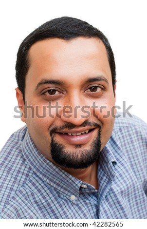 A portrait of an Indian businessman - isolated on white. Shallow Depth of Field