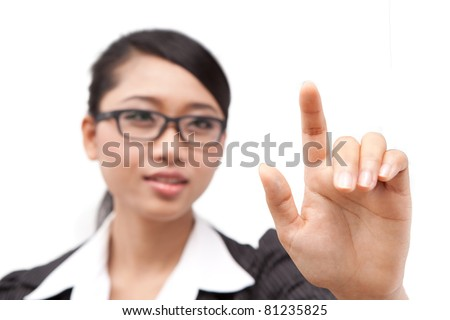 A portrait of Asia business woman. pressing her finger on touch screen. - stock photo