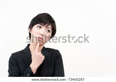 a portrait of asian businesswoman thinking - stock photo