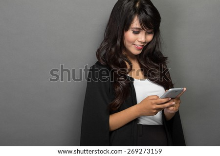 A portrait of Asian businesswoman with her phone - stock photo