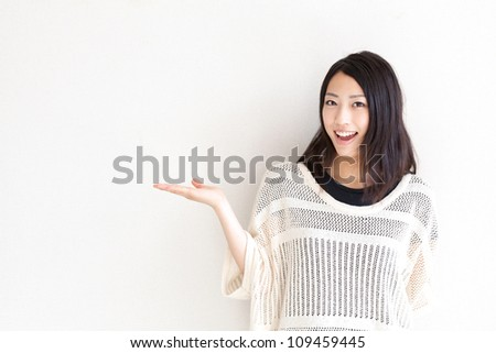 a portrait of asian woman showing on white background - stock photo