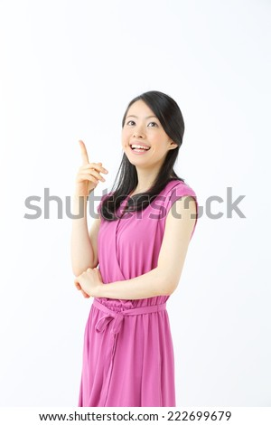 a portrait of attractive asian woman thinking - stock photo