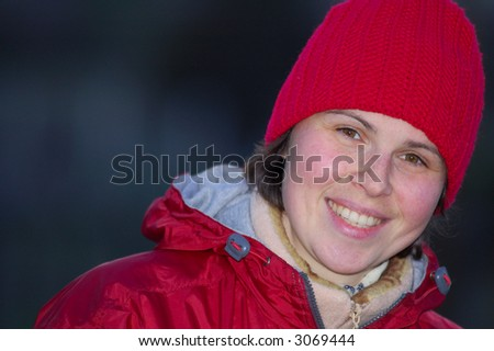 A portrait of attractive smiling young woman. - stock photo