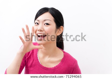 a portrait of beautiful asian woman cheering - stock photo