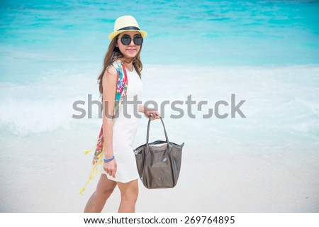 A portrait of beautiful asian woman on the beach - stock photo