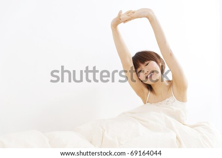 a portrait of beautiful asian woman on the bed - stock photo