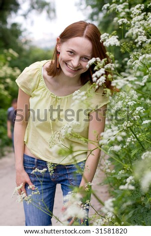 a portrait of beautiful woman is in flowers