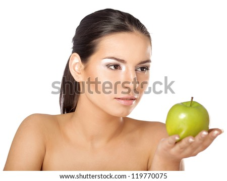 A portrait of beautiful young woman with a green apple on her hand - on white background