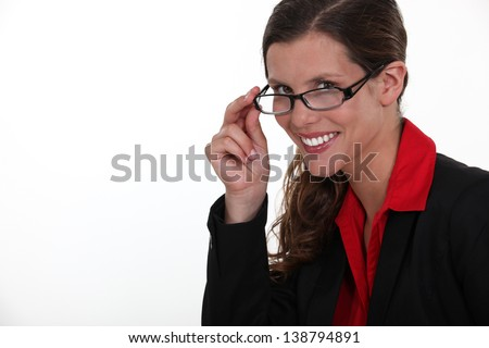 A portrait of businesswoman adjusting her glasses.