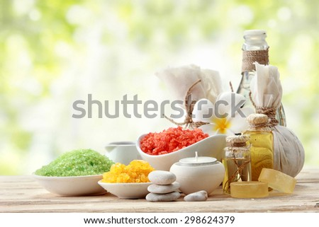 A portrait of Essentials oil and minerals salt, outdoor background - stock photo