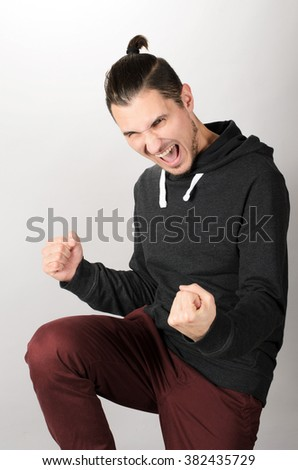 A portrait of happy excited young man  - stock photo