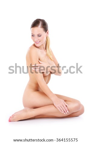 A portrait of happy naked woman sitting over white background