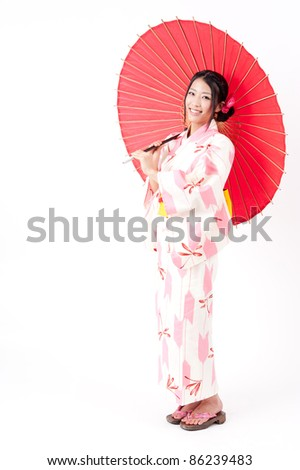 a portrait of japanese kimono woman with red traditional umbrella - stock photo