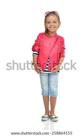 A portrait of laughing fashion little girl full body standing in sunglasses isolated on a white background - stock photo