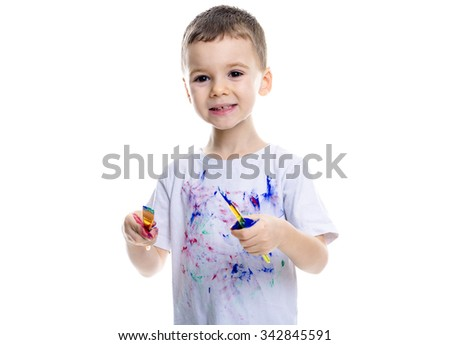 A Portrait of little boy with paints on hands isolated on white background - stock photo