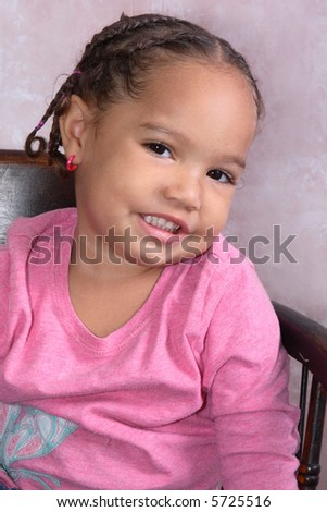A portrait of little toddler girl posed innocent and happy