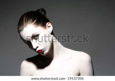 a portrait of make up lady in strong pose - stock photo
