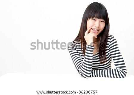a portrait of pretty asian woman looking isolated on white background