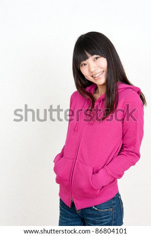 a portrait of pretty asian woman wearing parka - stock photo