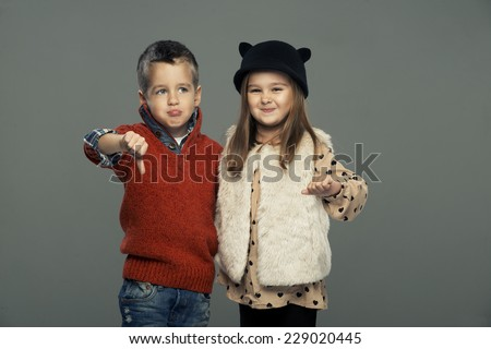 A portrait of sad girl and  boy. Thumbs down  - stock photo