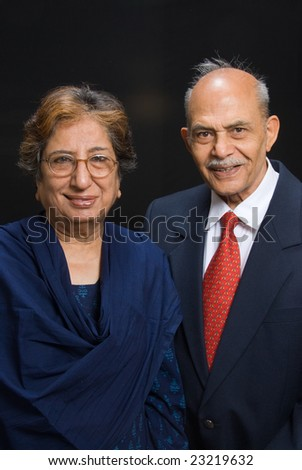 A portrait of senior Asian / East Indian couple smiling into the camera - stock photo