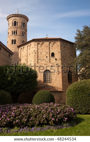 A portrait of the Baptistry of Neon, Ravenna, Italy, with flowers in the foreground - stock photo
