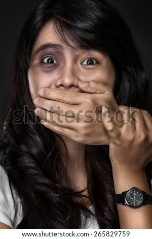 A portrait of the fear of woman victim of domestic violence and abuse - stock photo