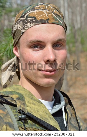 A portrait of the young man in forest. - stock photo