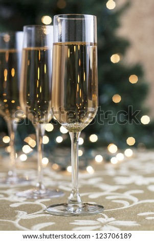 A portrait of three glasses of champagne on holiday season - stock photo