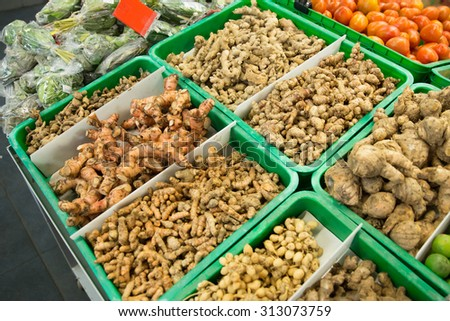 A portrait of turmeric root and other herbs for alternative medicine ,spa products and food ingredient, in a market stall - stock photo