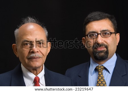 A portrait of two Asian business executives - stock photo