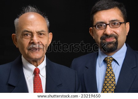 A portrait of two Asian business executives