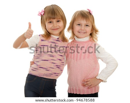 A portrait of two cheerful little girls; isolated on the white background