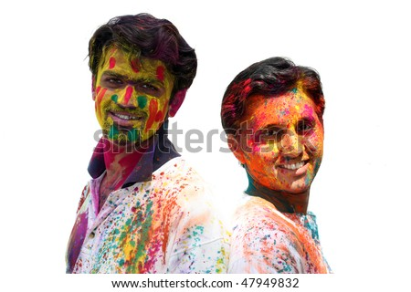 A portrait of two Indian friends with their faces traditionally covered, during HOLI festival - stock photo