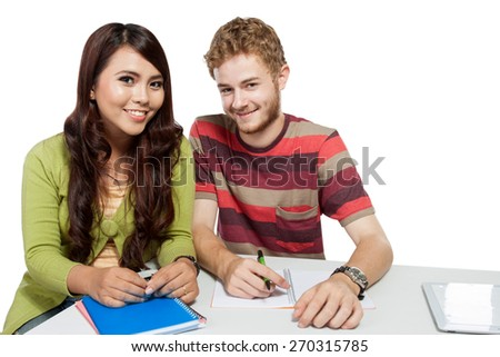 A portrait of two smiling college students studying together